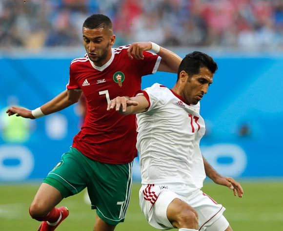 Hakim Ziyach (L) of Morocco and Vahid Amiri of Iran in action during the FIFA World Cup 2018 group B preliminary round soccer match between Morocco and Iran in St.Petersburg, Russia, 15 June 2018.