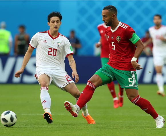 Mehdi Benatia of Morocco (R) and Sardar Azmoun of Iran in action during the FIFA World Cup 2018 group B preliminary round soccer match between Morocco and Iran in St.Petersburg, Russia, 15 June 2018.