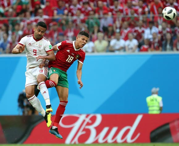 epa06810574 Amine Harit of Morocco (R) and Omid Ebrahimi of Iran in action during the FIFA World Cup 2018 group B preliminary round soccer match between Morocco and Iran in St.Petersburg, Russia, 15 June 2018.