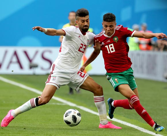 epa06810575 Amine Harit of Morocco (R) and Ramin Rezaeian of Iran in action during the FIFA World Cup 2018 group B preliminary round soccer match between Morocco and Iran in St.Petersburg, Russia, 15 June 2018.