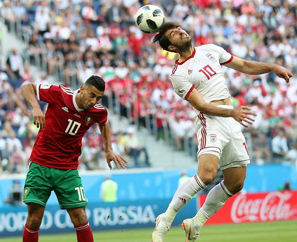 epa06810588 Younes Belhanda of Morocco (L) and Karim Ansarifard of Iran in action during the FIFA World Cup 2018 group B preliminary round soccer match between Morocco and Iran in St.Petersburg, Russia, 15 June 2018.