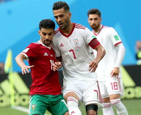 epa06810609 Masoud Shojaei of Iran and Mbark Boussoufa of Morocco (L) in action during the FIFA World Cup 2018 group B preliminary round soccer match between Morocco and Iran in St.Petersburg, Russia, 15 June 2018.