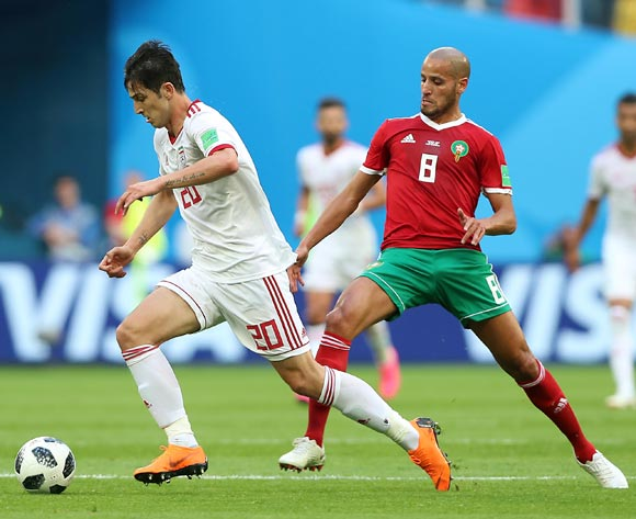 Karim El Ahmadi of Morocco (R) and Sardar Azmoun of Iran in action during the FIFA World Cup 2018 group B preliminary round soccer match between Morocco and Iran in St.Petersburg, Russia, 15 June 2018.