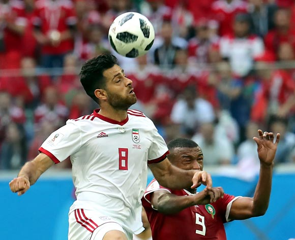 epa06810611 Morteza Pouraliganji of Iran and Ayoub El Kaabi of Morocco (R) in action during the FIFA World Cup 2018 group B preliminary round soccer match between Morocco and Iran in St.Petersburg, Russia, 15 June 2018.
