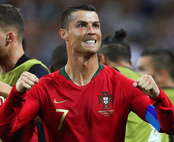 epa06811235 Cristiano Ronaldo of Portugal celebrates after scoring the 2-1 lead during the FIFA World Cup 2018 group B preliminary round soccer match between Portugal and Spain in Sochi, Russia, 15 June 2018.