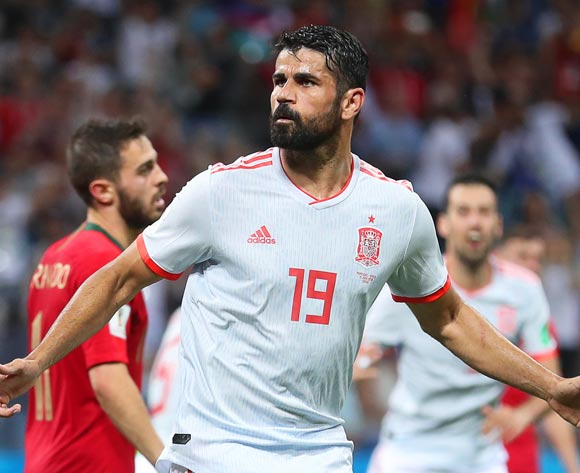 epa06811418 Diego Costa of Spain celebrates after scoring the 2-2 equalizer during the FIFA World Cup 2018 group B preliminary round soccer match between Portugal and Spain in Sochi, Russia, 15 June 2018.