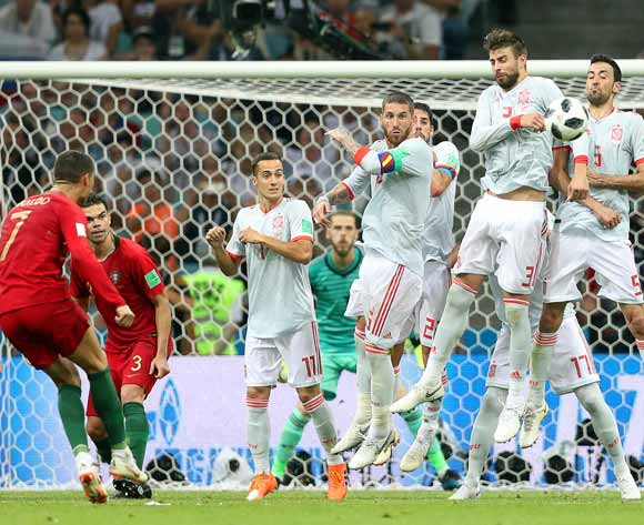 epa06811553 Cristiano Ronaldo (2-L) of Portugal converts a free kick to score the 3-3 equalizer during the FIFA World Cup 2018 group B preliminary round soccer match between Portugal and Spain in Sochi, Russia, 15 June 2018.
