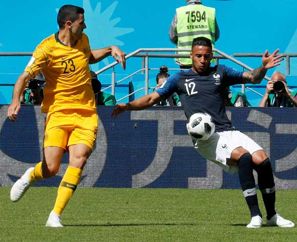 epa06812364 Corentin Tolisso of France (R) and Tom Rogic of Australia in action during the FIFA World Cup 2018 group C preliminary round soccer match between France and Australia in Kazan, Russia, 16 June 2018.