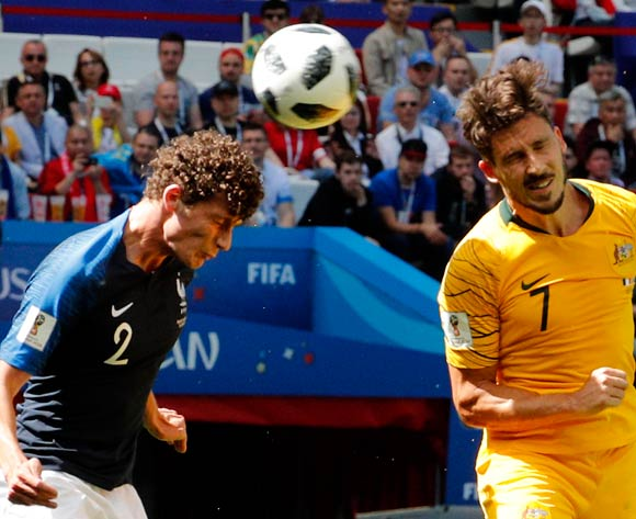 epa06812381 Mathew Leckie of Australia (R) and Benjamin Pavard of France in action during the FIFA World Cup 2018 group C preliminary round soccer match between France and Australia in Kazan, Russia, 16 June 2018.