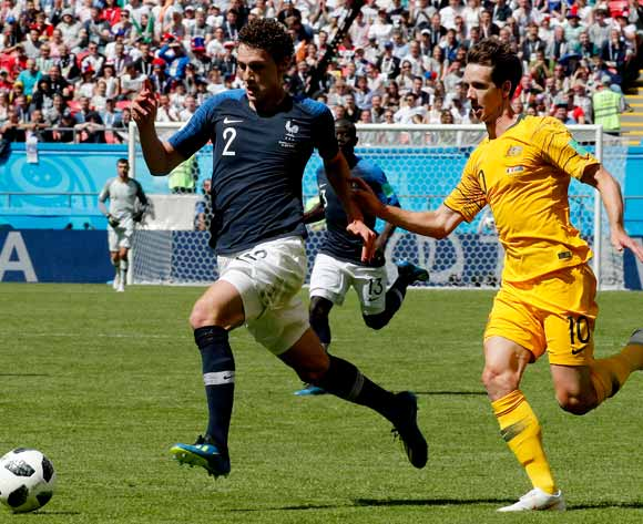 epa06812389 Benjamin Pavard of France (L) and Robbie Kruse of Australia in action during the FIFA World Cup 2018 group C preliminary round soccer match between France and Australia in Kazan, Russia, 16 June 2018.