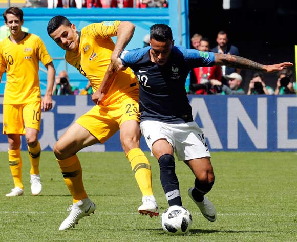 epa06812397 Corentin Tolisso of France (R) and Tom Rogic of Australia in action during the FIFA World Cup 2018 group C preliminary round soccer match between France and Australia in Kazan, Russia, 16 June 2018.