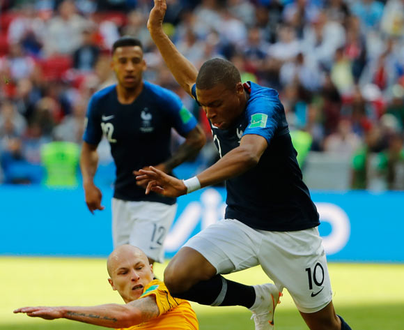 epa06812435 Aaron Mooy (down) of Australia and Kylian Mbappe of France in action during the FIFA World Cup 2018 group C preliminary round soccer match between France and Australia in Kazan, Russia, 16 June 2018.