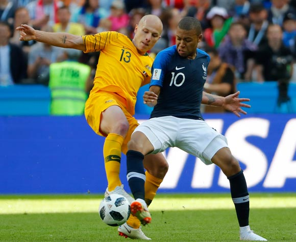 epa06812669 Kylian Mbappe (R) of France and Aaron Mooy of Australia in action during the FIFA World Cup 2018 group C preliminary round soccer match between France and Australia in Kazan, Russia, 16 June 2018.