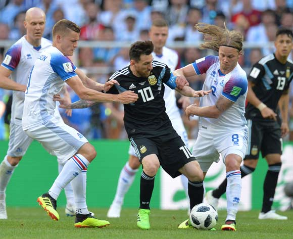 epa06813019 Birkir Bjarnason (R) of Iceland in action against Lionel Messi (C) of Argentina during the FIFA World Cup 2018 group D preliminary round soccer match between Argentina and Iceland in Moscow, Russia, 16 June 2018.