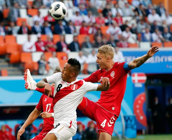 epa06813754 Christian Cueva of Peru (C) and Simon Kjaer of Denmark (R) in action during the FIFA World Cup 2018 group C preliminary round soccer match between Peru and Denmark in Saransk, Russia, 16 June 2018.