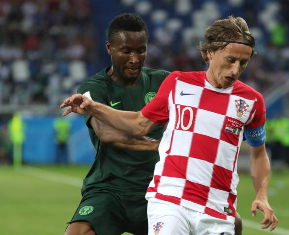 epa06814251 Luka Modric (R) of Croatia and John Obi Mikel of Nigeria in action during the FIFA World Cup 2018 group D preliminary round soccer match between Croatia and Nigeria in Kaliningrad, Russia, 16 June 2018