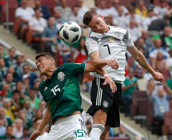 epa06816071 Julian Draxler (R) of Germany and Hector Moreno of Mexico in action during the FIFA World Cup 2018 group F preliminary round soccer match between Germany and Mexico in Moscow, Russia, 17 June 2018.