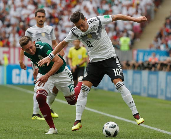 epa06816094 Mesut Oezil (R) of Germany in action against Hector Herrera of Mexico during the FIFA World Cup 2018 group F preliminary round soccer match between Germany and Mexico in Moscow, Russia, 17 June 2018.