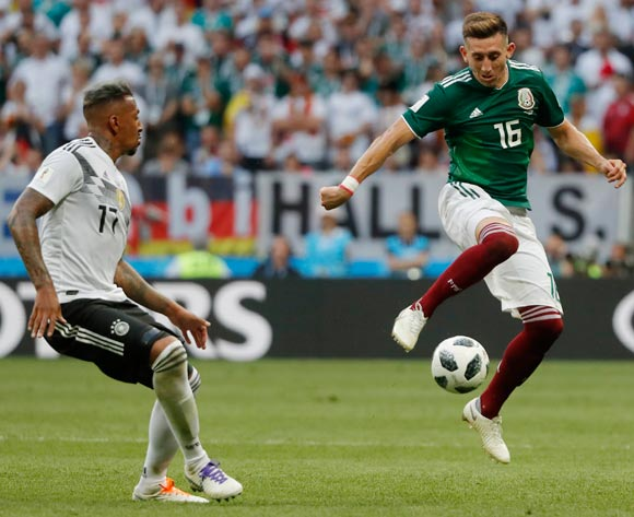 epa06816456 Jerome Boateng (L) of Germany and Hector Herrera of Mexico in action during the FIFA World Cup 2018 group F preliminary round soccer match between Germany and Mexico in Moscow, Russia, 17 June 2018.