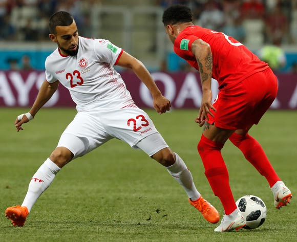 epa06819669 Naim Sliti (L) of Tunisia and Kyle Walker of England in action during the FIFA World Cup 2018 group G preliminary round soccer match between Tunisia and England in Volgograd, Russia, 18 June 2018.