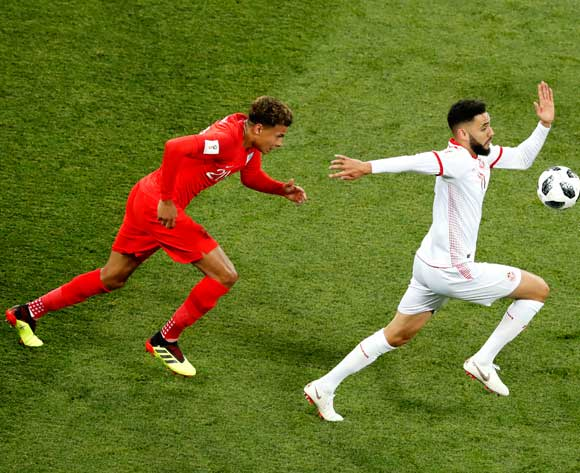 epa06819684 Dele Alli of England (L) and Dylan Bronn of Tunisia in action during the FIFA World Cup 2018 group G preliminary round soccer match between Tunisia and England in Volgograd, Russia, 18 June 2018.