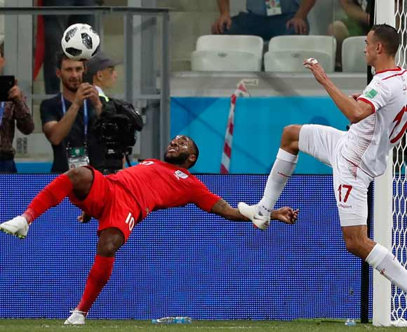 epa06819696 Raheem Sterling (L) of England in action  during the FIFA World Cup 2018 group G preliminary round soccer match between Tunisia and England in Volgograd, Russia, 18 June 2018.