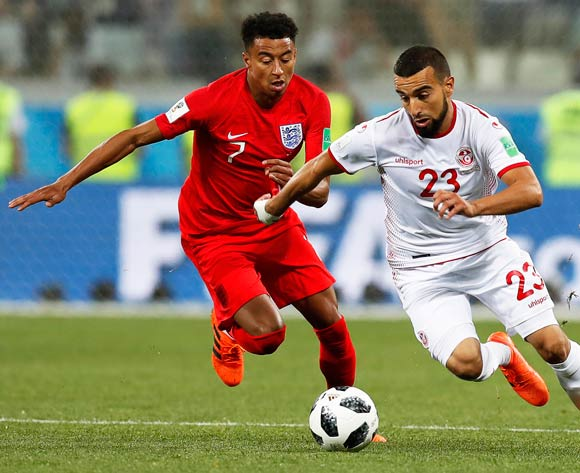 epa06819750 Naim Sliti (R) of Tunisia in action against Jesse Lingard (L) of England during the FIFA World Cup 2018 group G preliminary round soccer match between Tunisia and England in Volgograd, Russia, 18 June 2018.