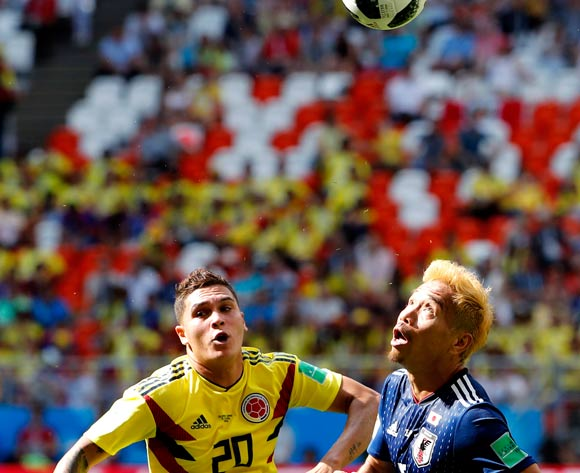 epa06820864 Juan Quintero (L) of Colombia and Yuto Nagatomo of Japan in action during the FIFA World Cup 2018 group H preliminary round soccer match between Colombia and Japan in Saransk, Russia, 19 June 2018.