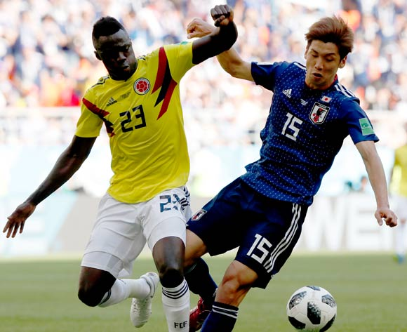 epa06821066 Yuya Osako of Japan (R) and Davinson Sanchez of Colombia in action during the FIFA World Cup 2018 group H preliminary round soccer match between Colombia and Japan in Saransk, Russia, 19 June 2018.