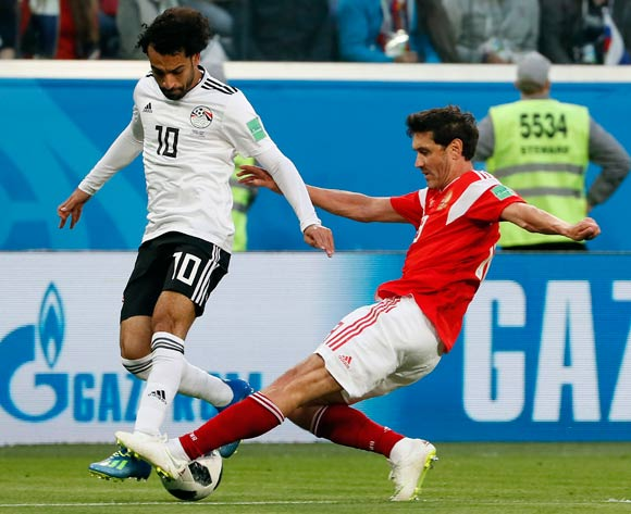 epa06822419  Yuri Zhirkov of Russia (R) and Mohamed Salah of Egypt in action during the FIFA World Cup 2018 group A preliminary round soccer match between Russia and Egypt in St.Petersburg, Russia, 19 June 2018.