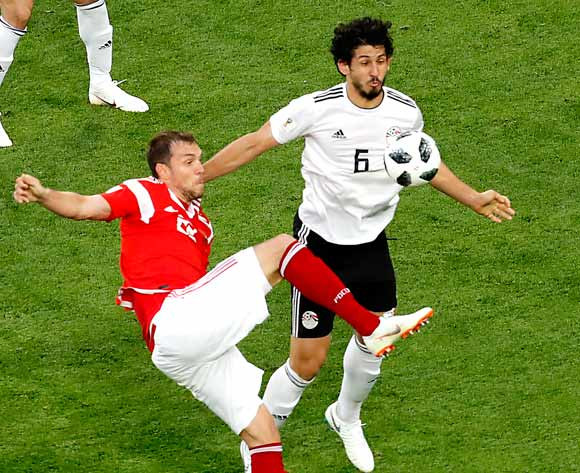 epa06822499 Artem Dzyuba of Russia (L) and Ahmed Hegazy of Egypt in action during the FIFA World Cup 2018 group A preliminary round soccer match between Russia and Egypt in St.Petersburg, Russia, 19 June 2018.