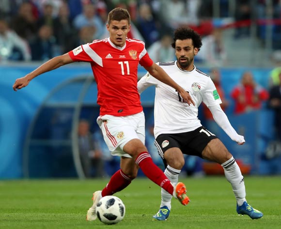 epa06822684 Roman Zobnin of Russia and Mohamed Salah (R) of Egypt in action during the FIFA World Cup 2018 group A preliminary round soccer match between Russia and Egypt in St.Petersburg, Russia, 19 June 2018.