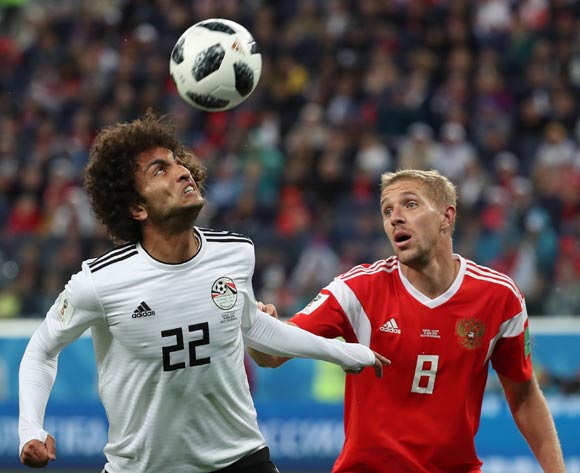 Amr Warda (L) of Egypt and Yury Gazinsky of Russia in action during the FIFA World Cup 2018 group A preliminary round soccer match between Russia and Egypt in St.Petersburg, Russia, 19 June 2018.