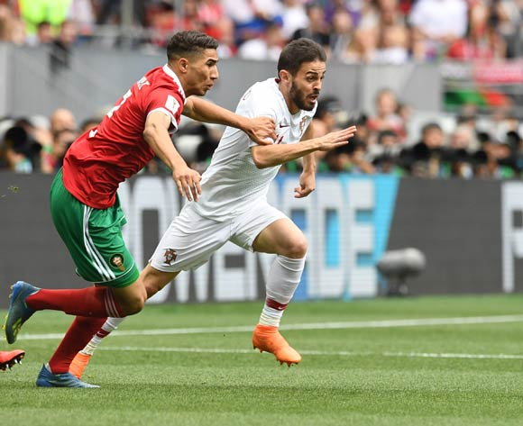 epa06824005 Bernardo Silva (R) of Portugal and Achraf Hakimi of Morocco in action during the FIFA World Cup 2018 group B preliminary round soccer match between Portugal and Morocco in Moscow, Russia, 20 June 2018.