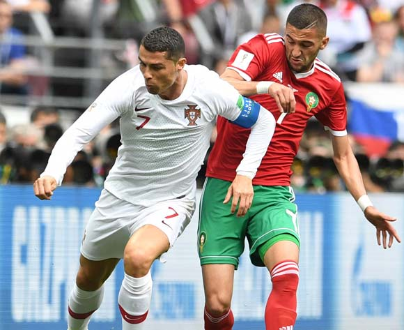 epa06824039 Cristiano Ronaldo (L) of Portugal and Hakim Ziyach of Morocco in action during the FIFA World Cup 2018 group B preliminary round soccer match between Portugal and Morocco in Moscow, Russia, 20 June 2018.