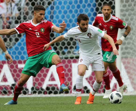epa06824040 Achraf Hakimi of Morocco (L) and Bernardo Silva of Portugal in action during the FIFA World Cup 2018 group B preliminary round soccer match between Portugal and Morocco in Moscow, Russia, 20 June 2018.