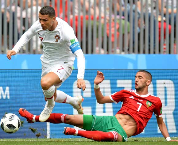 epa06824048 Cristiano Ronaldo (L) of Portugal and Hakim Ziyach of Morocco in action  during the FIFA World Cup 2018 group B preliminary round soccer match between Portugal and Morocco in Moscow, Russia, 20 June 2018.