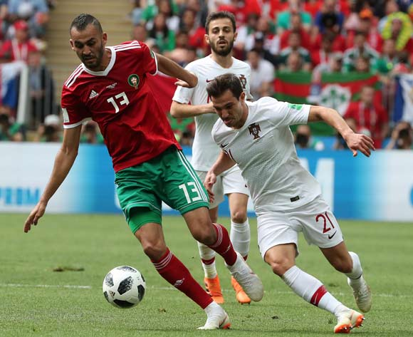 epa06824172 Cedric of Portugal (R) and Khalid Boutaib of Morocco in action during the FIFA World Cup 2018 group B preliminary round soccer match between Portugal and Morocco in Moscow, Russia, 20 June 2018.