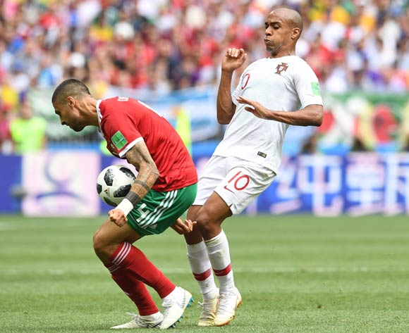 epa06824197 Joao Mario (R) of Portugal  and Manuel da Costa of Morocco in action during the FIFA World Cup 2018 group B preliminary round soccer match between Portugal and Morocco in Moscow, Russia, 20 June 2018.