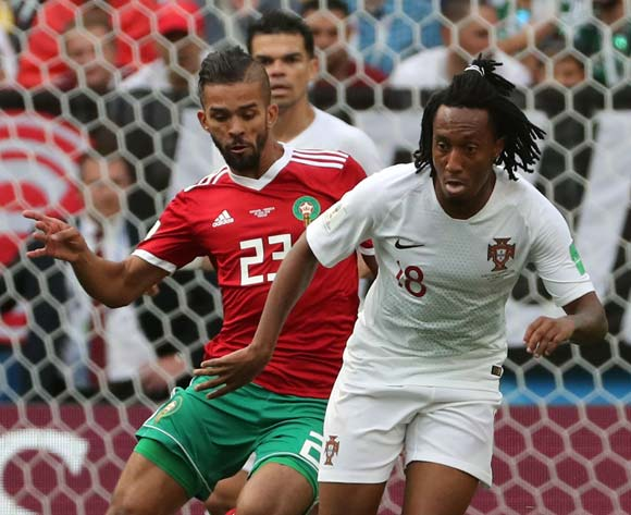 epa06824455 Gelson Martins of Portugal (R) and Mehdi Carcela of Morocco in action  during the FIFA World Cup 2018 group B preliminary round soccer match between Portugal and Morocco in Moscow, Russia, 20 June 2018. Left is Mehdi Benatia of Morocco.