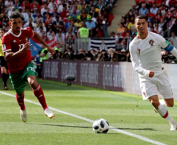 epa06824525 Cristiano Ronaldo of Portugal (R) and Nabil Dirar of Moroccoo in action during the FIFA World Cup 2018 group B preliminary round soccer match between Portugal and Morocco in Moscow, Russia, 20 June 2018.