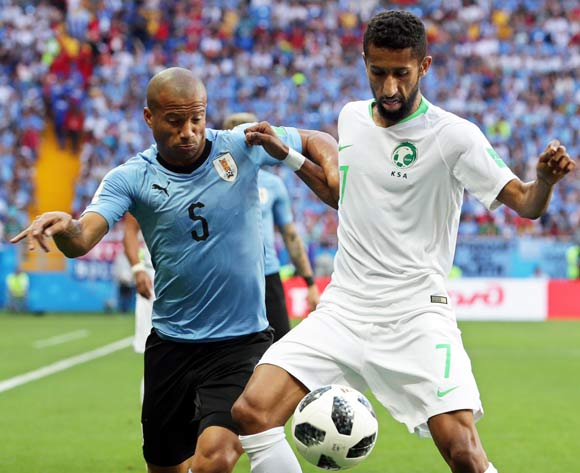epa06824819 Carlos Sanchez (L) of Uruguay in action against Salman Al-Faraj (R) of Saudi Arabia during the FIFA World Cup 2018 group A preliminary round soccer match between Uruguay and Saudi Arabia in Rostov-On-Don, Russia, 20 June 2018.