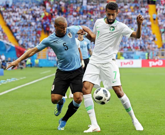 Carlos Sanchez (L) of Uruguay in action against Salman Al-Faraj (R) of Saudi Arabia during the FIFA World Cup 2018 group A preliminary round soccer match between Uruguay and Saudi Arabia in Rostov-On-Don, Russia, 20 June 2018.