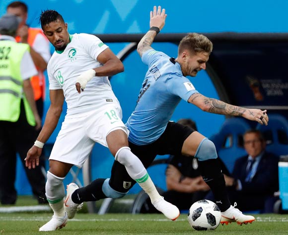 epa06824841 Salem Al-Dawsari of Saudi Arabia (L) and Guillermo Varela of Uruguay in action during prior the FIFA World Cup 2018 group A preliminary round soccer match between Uruguay and Saudi Arabia in Rostov-On-Don, Russia, 20 June 2018.