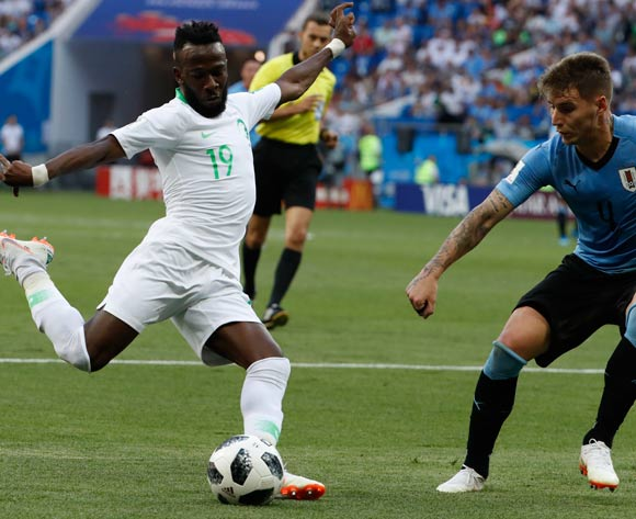 epa06824865 Fahad Al-Muwallad of Saudi Arabia (L) and Guillermo Varela of Uruguay in action during the FIFA World Cup 2018 group A preliminary round soccer match between Uruguay and Saudi Arabia in Rostov-On-Don, Russia, 20 June 2018.