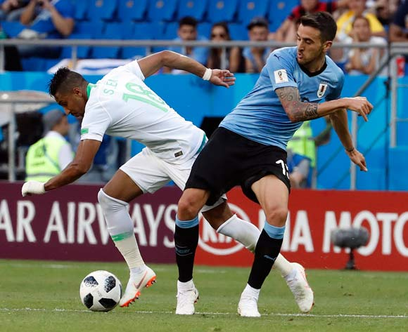 epa06824894 Matias Vecino of Uruguay (R) and Salem Al-Dawsari of Saudi Arabia in action during the FIFA World Cup 2018 group A preliminary round soccer match between Uruguay and Saudi Arabia in Rostov-On-Don, Russia, 20 June 2018.