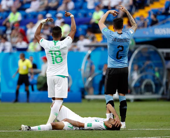 epa06824914 Taiseer Al Jassam of Saudi Arabia (down) injured on the pitch during the FIFA World Cup 2018 group A preliminary round soccer match between Uruguay and Saudi Arabia in Rostov-On-Don, Russia, 20 June 2018.