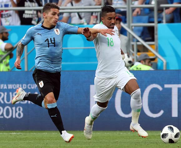 epa06825018 Lucas Torreira of Uruguay (L) and Salem Al-Dawsari of Saudi Arabia in action during the FIFA World Cup 2018 group A preliminary round soccer match between Uruguay and Saudi Arabia in Rostov-On-Don, Russia, 20 June 2018.