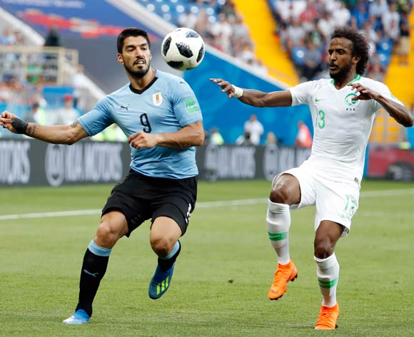 Yasir Al-Shahrani of Saudi Arabia (R) and Luis Suarez of Uruguay in action during the FIFA World Cup 2018 group A preliminary round soccer match between Uruguay and Saudi Arabia in Rostov-On-Don, Russia, 20 June 2018.