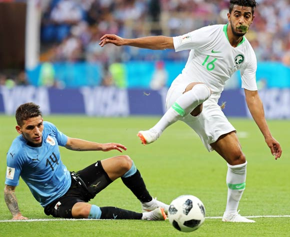 epa06825051 Lucas Torreira (L) of Uruguay in action against Hussain Al Mogahwi (R) of Saudi Arabia during the FIFA World Cup 2018 group A preliminary round soccer match between Uruguay and Saudi Arabia in Rostov-On-Don, Russia, 20 June 2018.